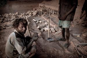 Squatting Brick Worker