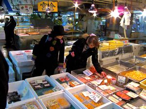 two ladies selecting fisn products
