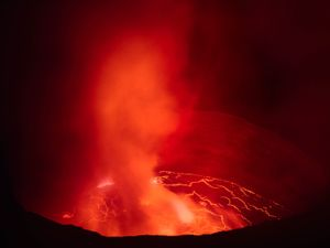 """""""The Nyiragongo volcano in the Democratic Republic of Congo is a truly amazing sight, but the fact that it is remote and located in a conflict zone makes access complicated. I feel privileged to have been there and I think the images portray the unique beauty of the place."""" —Klaus Thymann"""