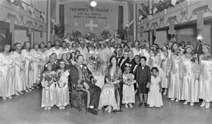 """Bishop C. M. """"Sweet Daddy"""" Grace and his congregation of the United House of Prayer for All People, c.1930s Courtesy of the Archives Center, National Museum of American History, Smithsonian Institution © scurlock"""