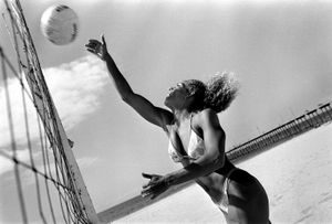 Jennifer Holdran practices spiking a volleyball at the beach.  Ethnicity: Panamanian • Irish • West Indian • Russian • African • Native Indian • French ©2014, Stephen Shames