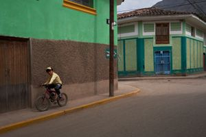 A boy on a bicycle, streets of Calca, Cusco, Peru