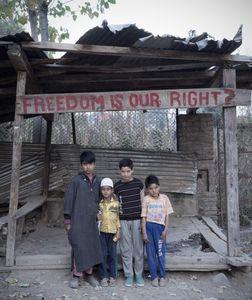Children under sign.