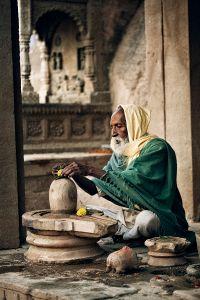 Varanasi, India: A Sadhu during his ritual puja in his Shiva Temple. © Matjaz Krivic