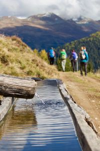 Water trough and hikers