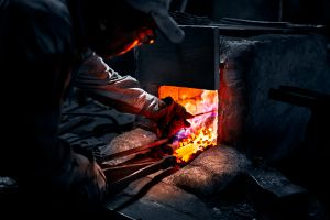 To form the base metal, a very hot bed of coals usually from pine charcoal which heats up to about a thousand degrees.