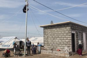 11/01/2015 -- Kirkuk, Iraq -- A young displaced person tries to fix the electricity in the Laylan IDP camp, south of Kirkuk. Metrography IDP project is funded by Free Press Unlimited