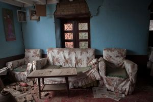 An emty couch and chairs of a destroyed house in Bhaktapur, Nepal