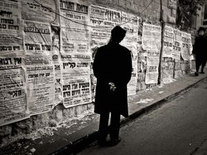Orthodox Jew reading local gossip printed to shame wrong doers,