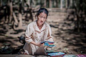 A farmer's wife selling souvenirs in Ban Long Lan village Luang Prabang Province.Laos.