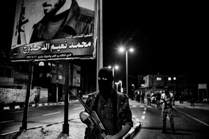 Fighters of al-Naser Salah al-Deen Brigades parade in the streets of Gaza at night