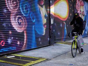 Bicyclist and Graffitti, NYC