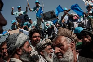 Supporters of Afghan presidential candidate and former foreign minister Dr Abdullah Abdullah gather at a rally at the National Stadium in Kabul, Afghanistan, on August 17, 2009. © Adam Ferguson