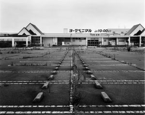"Parking lot at the big super market inside the exclusion zone. From the series ""Fragments/Fukushima"" © Kosuke Okahara"
