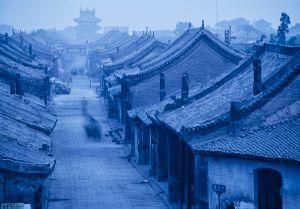 Pingyao, China: Part of an ancient city of  Pingyao at dusk. © Matjaz Krivic