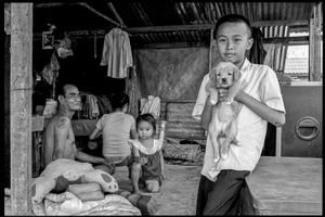A family in Vientiane, Laos. Near the Mekong.