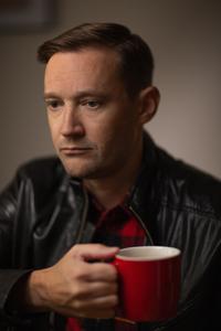 Man with Sunday morning coffee