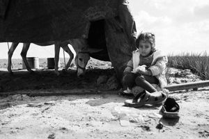 Hala Abu Daqqa is seen eating her lunch in the family's farmland in Khan Younis, southern Gaza on Nov. 3rd 2014.The Abu Daqqa family has been living in a sn Khan Younis for three months now.