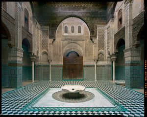 Courtyard of Attarin Madrasa in Fez, Morocco.