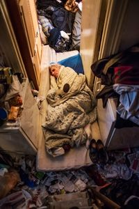 A mattress in a doorframe became George's living space for 6 months since he hosted a guest long-term in his bedroom.  © Corinna Kern