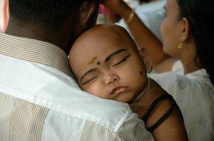 Father and child at the Chithirai Thiruvizha festival