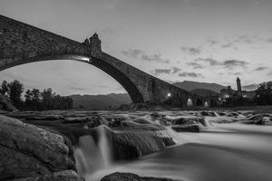 Old bridge on a slow river