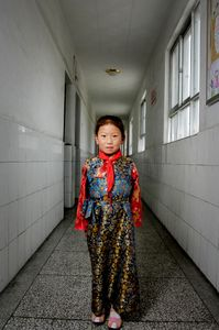 School girl in hall of elementary school in Lhasa, Tibet. © Forest McMullin