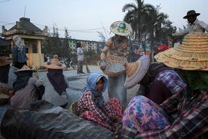 Road workers at their work near Yuzana Garden City, Yangon, Myanmar.