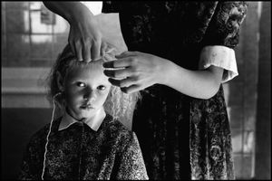 © George Webber - Braiding Maria's hair, 1999