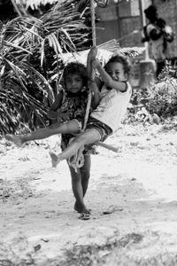 Ati children plays in a rope