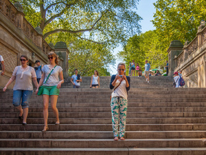 Checking Phone On Bethesda Terrace Steps