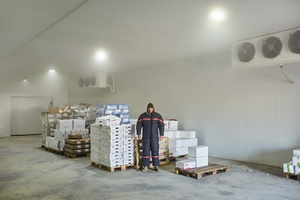Chamaa HQ. Valerio in cold storage cell for food.