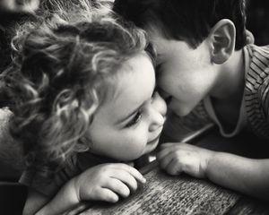 Geffen and Oren. sharing a secret and a kiss