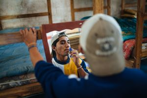 At morning, a migrant shaves his face before to leave the shelter where the migrants stay for some days for resting. Many shelters across Mexico help to the migrants during their journey to reach to United States. Arriaga, Mexico, January 20, 2008.