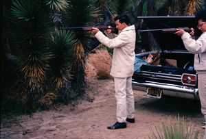 OLD SCHOOL COUPLE PRACTICES SHOOTING ON THE WEEKENDS.  THE HIGH DESSERT, CALIFORNIA.
