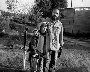 settler and his son