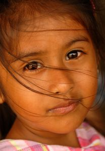 Latina female child with hair blowing