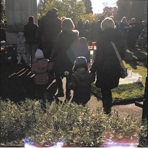 Child With White Poppy. Remembrance Day, East Bierley, Bradford. UK. Sunday 08 November  2015