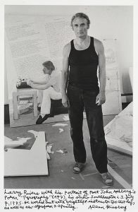 Larry Rivers with his portrait of Poet John Ashberys Poem Pyrography (1977), his studio Southhampton L.I. July 7, 1985. He worked out with weightlift instructor too that day as well as new styrofoam 3-D Painting. © Allen Ginsberg