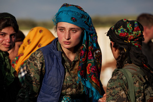 At a cemetery in Kobane, Syria, on 14 April, 2015, few members of YPJ (Women's Protection Units), mourn during the ceremony for Ageri, thier fellow fighter who was killed during clashes with Islamic State in Eastern frontline of Kobane, Syria.