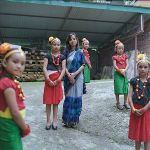 """Independence Day preparations in traditional costume. From the series """"Homebodies""""."""