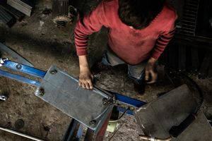 Kalled, 12, is from Al Bab - a city near Aleppo. He is working since he is 10 and is producing steel tables and other furniture. He doesn't attend school and supports his father to pay for high bills. He earns about €25 per week.