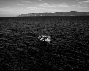Migrants reaching the Greek island of  Lesvos - Crossings Exhibition