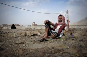Sitting at the top of a hill on an uninhabited plot of land in central Sana'a, a member of the nearby Muhamasheen community chews khat in the early evening hours.