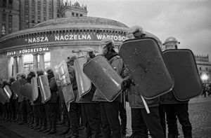 Heavy milicia presence at the Palace of Culture in Warsaw, during the last session of the XI Meeting of the Polish Communist Party (PZPR)  which saw the dissolution of the party. 29.01.1990 © Witold Krassowski (Poland), from the exhibition Transition.  Courtesy of the Noorderlicht Photofestival 2008.