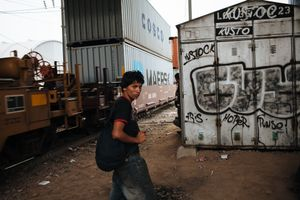 A young migrant with a backpack walks waiting for the train around loading station. At this moment, he achieved to arrive to Mexico City, however there is still a long journey to do for reaching the U.S. border, in Mexico City, May 20, 2008.