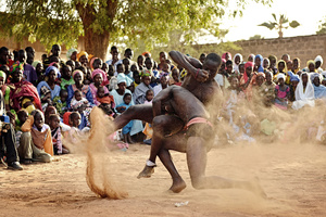 Two wrestlers in an occasional fight at a village party in the small place Soune on April 20, 2012. Wrestling is a traditional sport in Senegal, wrestling tournaments take place even in the smallest villages on the countryside.