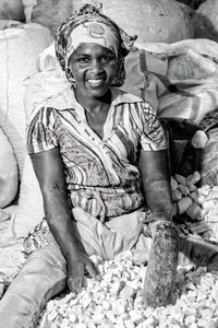 Women Workers.  Woman doing Manioc flour.