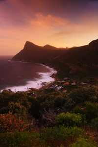 Remote village / This is Smitswinkel Bay, located on the Cape Peninsula, South Africa. The village looks so remote and secluded but is actually close to a tarred road. It can only be reached with a walk down the slope, it is a magical place.
