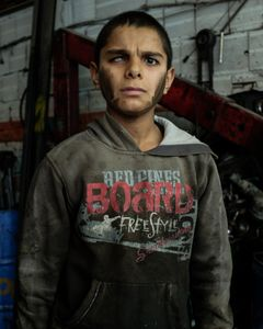 Abdul Kadir, 14, arrived one year ago with his older brother's family (25 years old). He came from Al Bab, a city near Aleppo, escaping from Isis. Abdul lost his right eye due to shrapnel. Instead of going to school he is working 13 hours per day as a car mechanic. He would prefer to attend school, but his family needs money to pay for rent and bills.